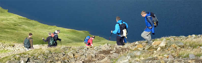 Walkers above Grisedale Tarn